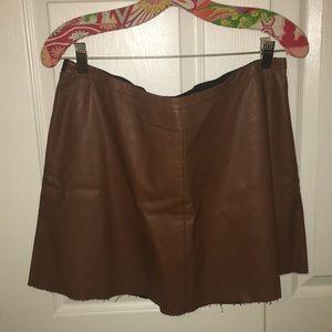 Vegan leather mini skirt.